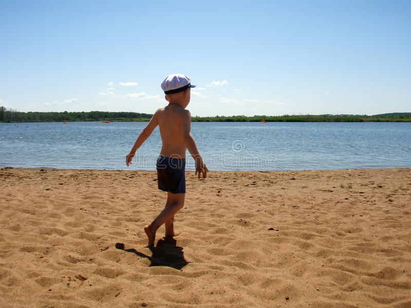 The boy on a beach royalty free stock photography
