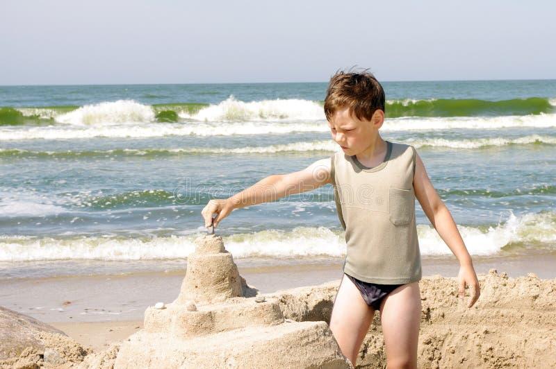 Boy on a beach stock image