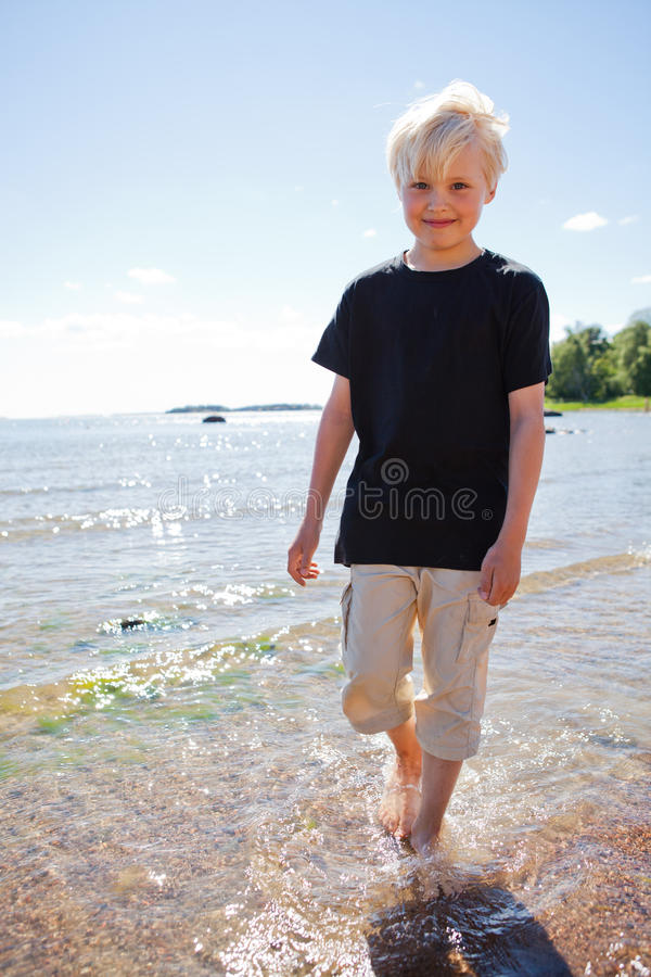 Download Boy on the beach stock photo. Image of walking, happy - 26567654