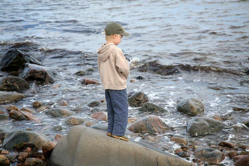 Boy at the beach stock photo