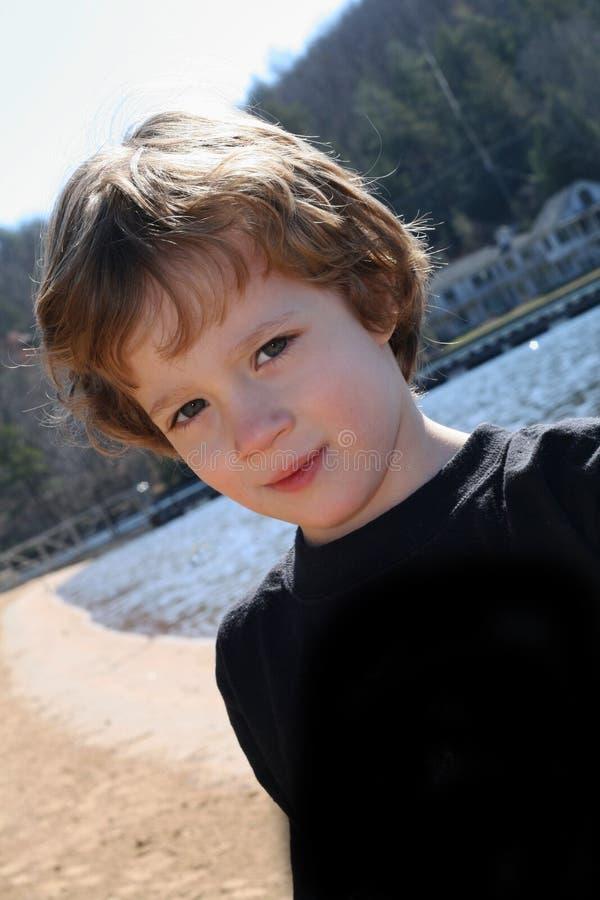 Boy on the beach royalty free stock photos