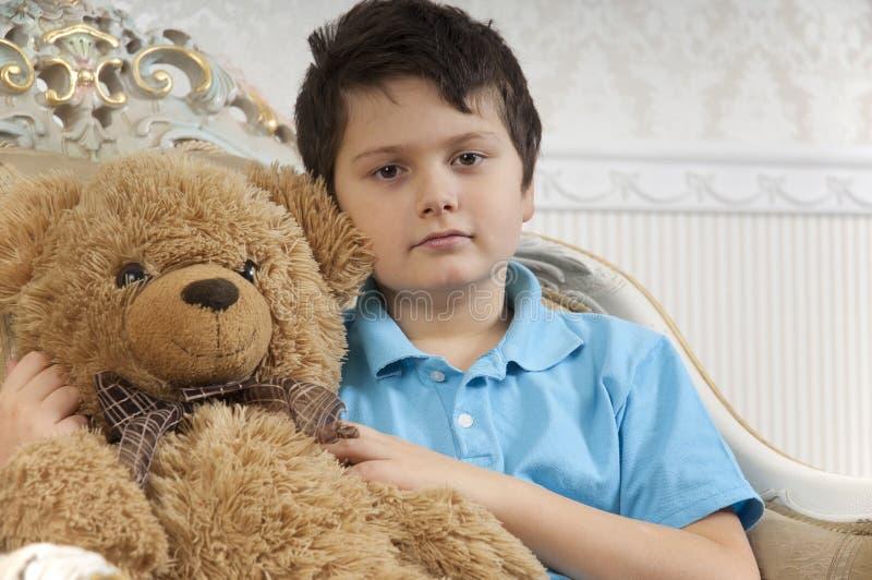 Boy with a bear stock photos