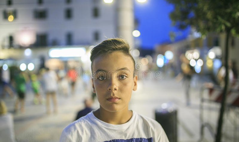 Boy with beautiful green eyes looking at the camera stock photo