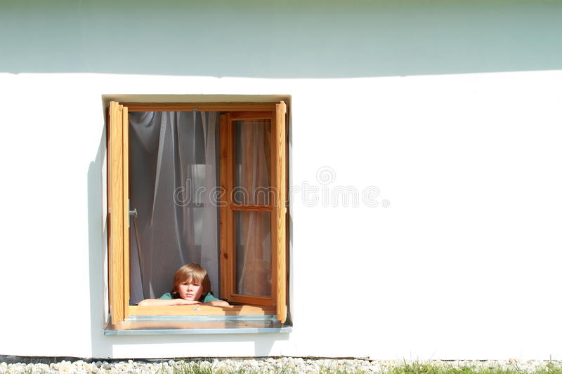 Download Boy behind in the window stock photo. Image of barefooted - 25493682
