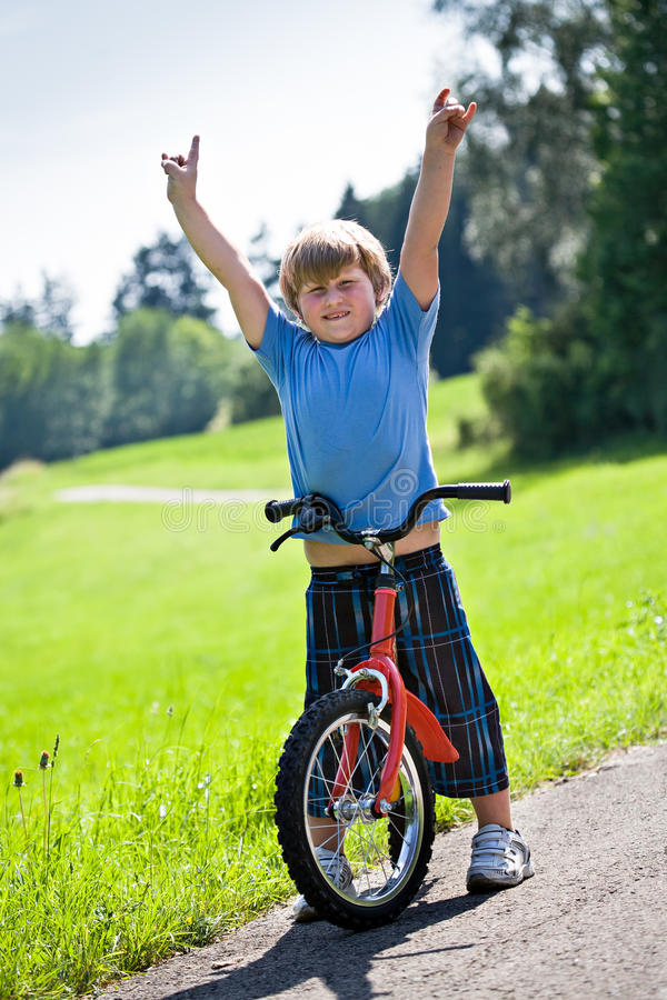 Download Boy with a bicycle stock photo. Image of yard, sunlight - 25365996