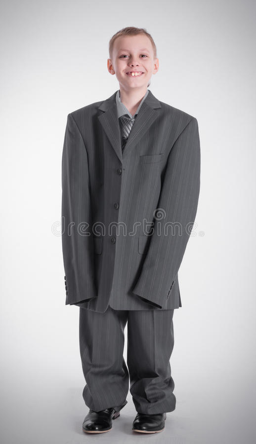 Boy in big business suit stock photo