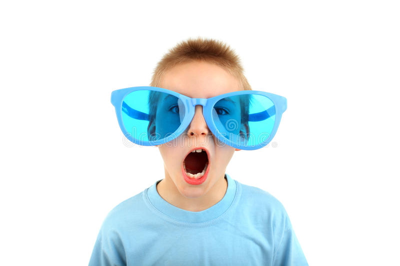 Boy in big glasses royalty free stock photos