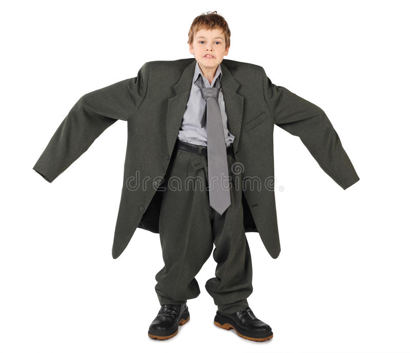 Boy in big man's suit and boots nads at sides stock photo