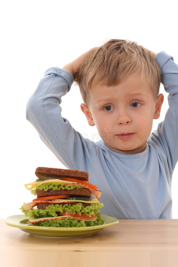 Boy and big sandwich stock photo