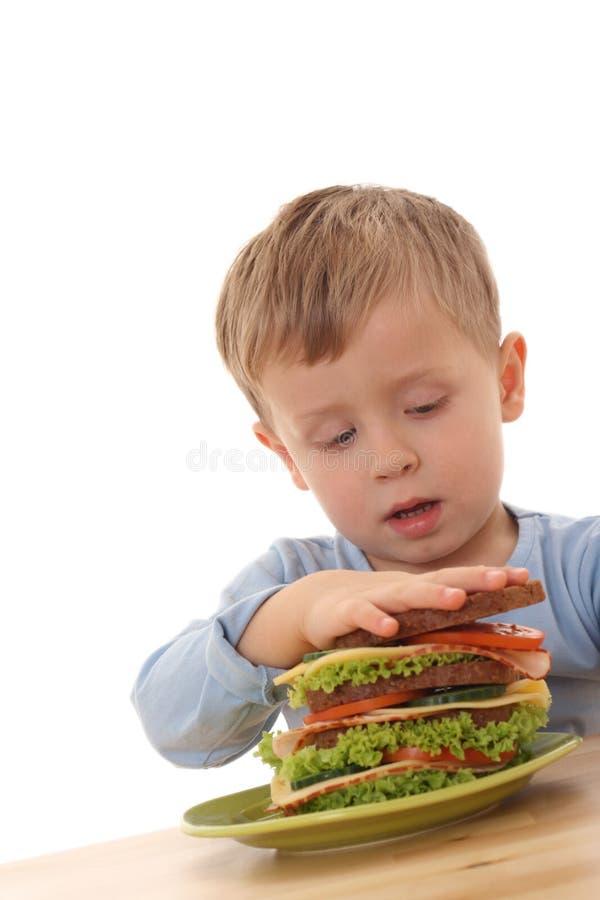 Boy and big sandwich royalty free stock image