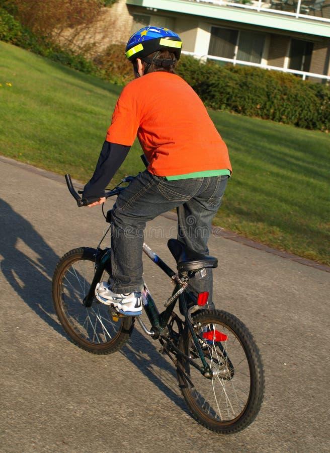 Boy on the bike stock image