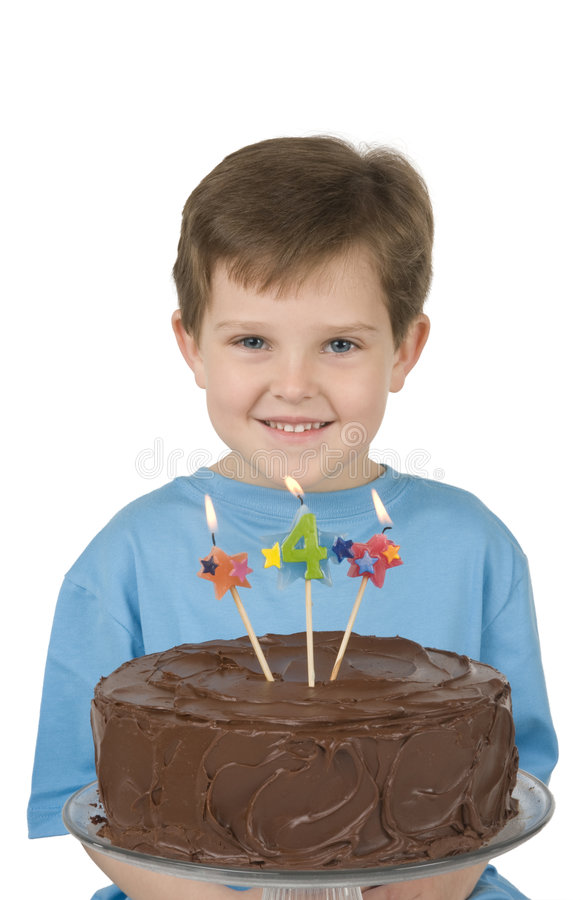 Boy with Birthday Cake. Boy with a birthday cake and candles royalty free stock photography