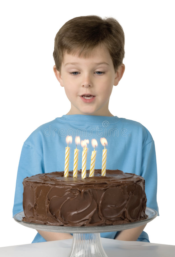 Boy with Birthday Cake. Boy with a birthday cake and candles royalty free stock photo