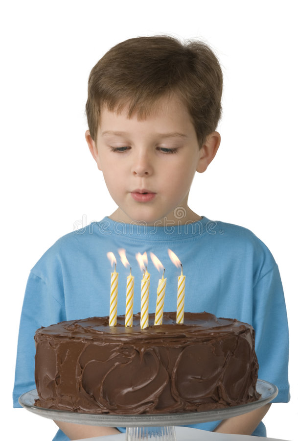 Boy with Birthday Cake. Boy with a birthday cake and candles stock photography