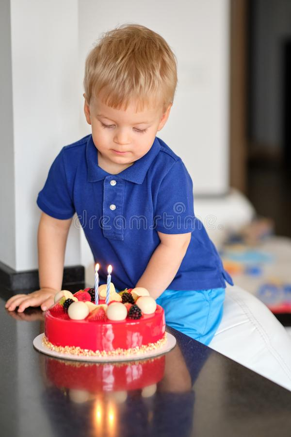 Boy with birthday cake. Two year old boy with birthday cake stock photography