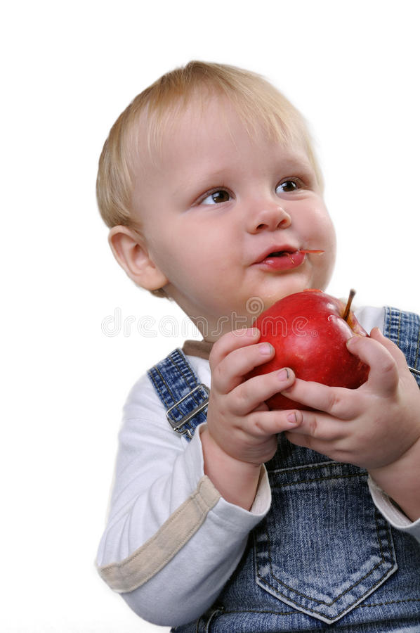 Boy biting an apple royalty free stock images