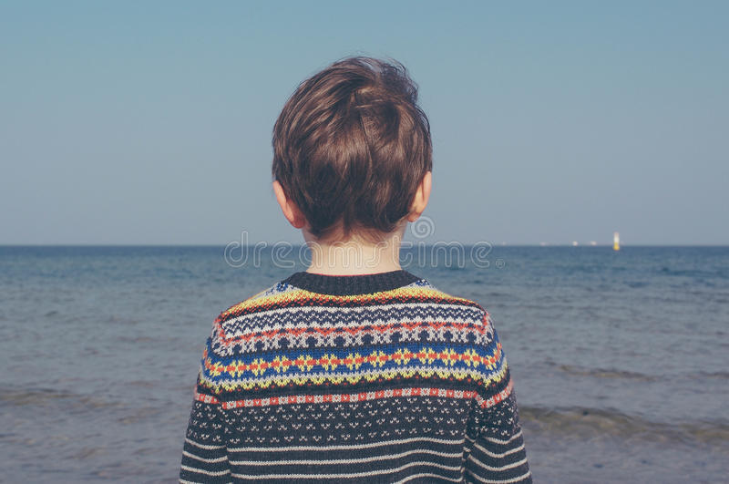 Boy In Black Blue White Sweater Near Shore During Daytime Free Public Domain Cc0 Image
