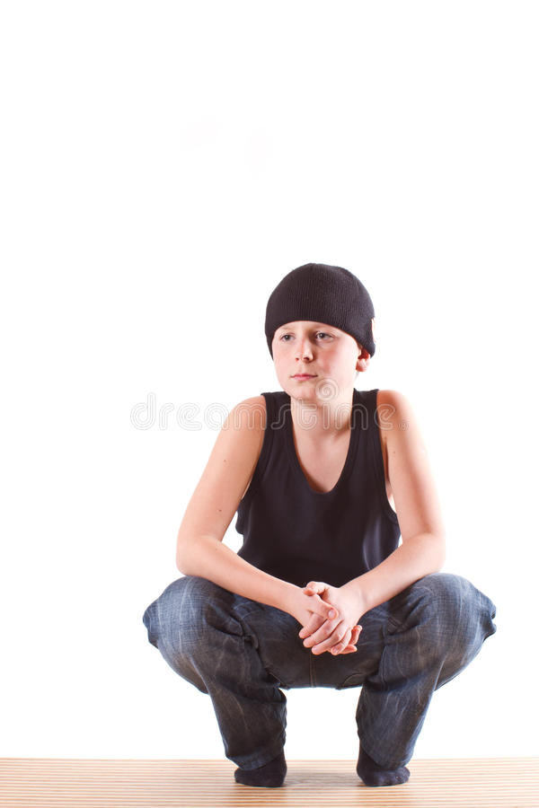 Boy in a black T-shirt and a black hat royalty free stock photo