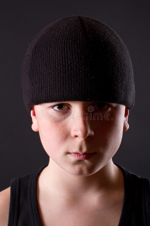 Boy in a black T-shirt and a black hat royalty free stock photos