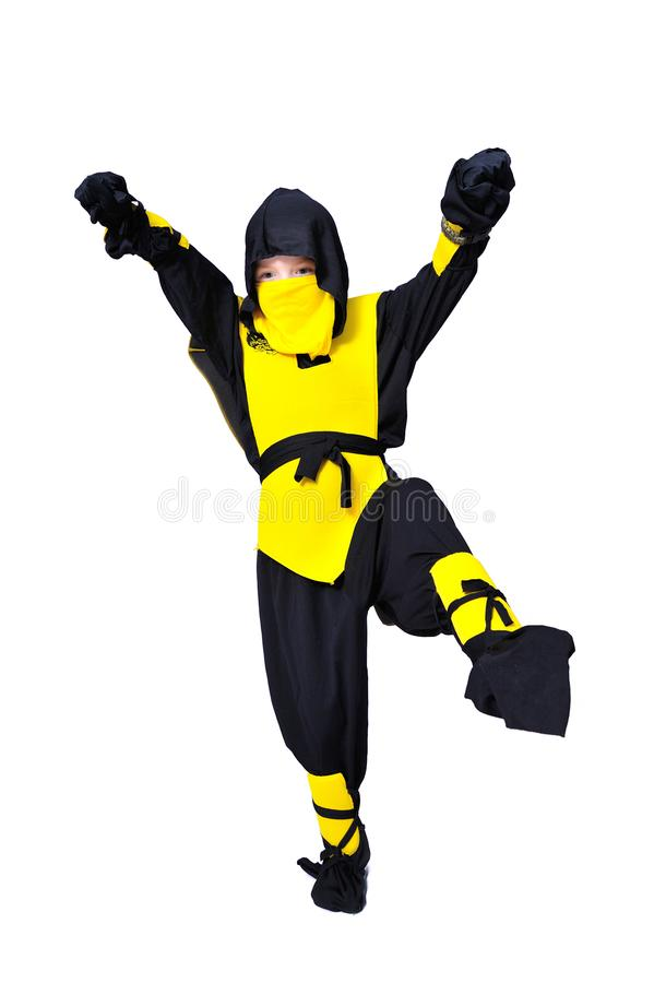 The seven-years old boy in black and yellow ninja suit with a ho stock image