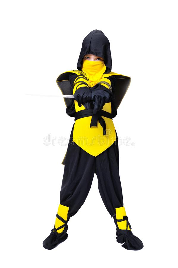 The seven-years old boy in black and yellow ninja suit with a ho stock photos
