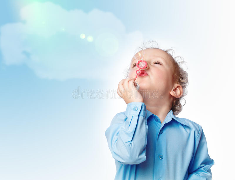 Boy blowing a bubble stock images