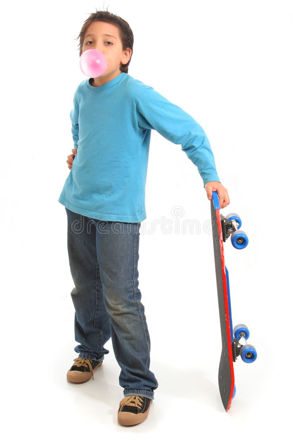 Boy blowing a bubble gum holding a skate royalty free stock photos