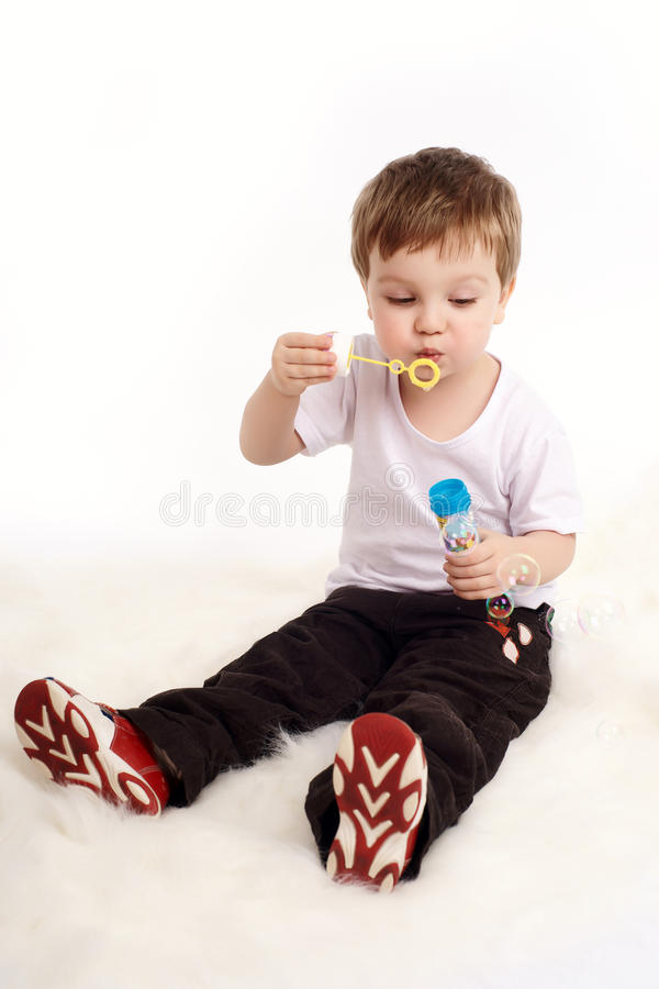 Download Boy Blowing Bubbles Royalty Free Stock Images - Image: 13261899