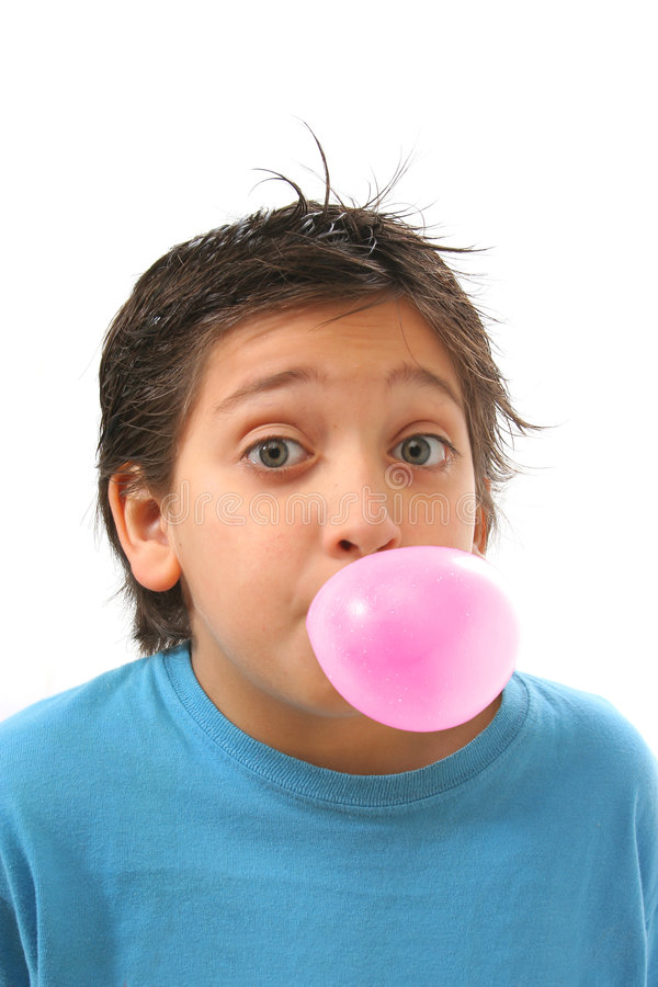 Boy blowing a pink bubble gum stock images