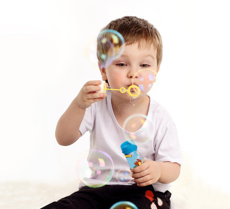 Download Boy blowing soap bubble stock image. Image of face, wind - 13261917