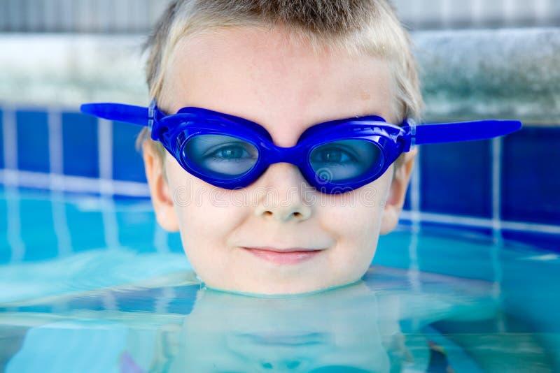 Boy in the blue stock photos