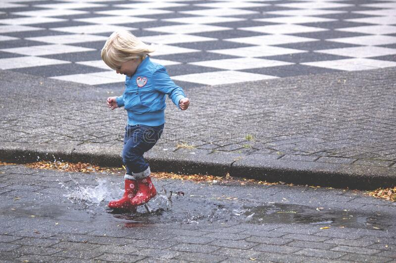 Boy In Blue Jacket Hopping On Water Puddle Free Public Domain Cc0 Image
