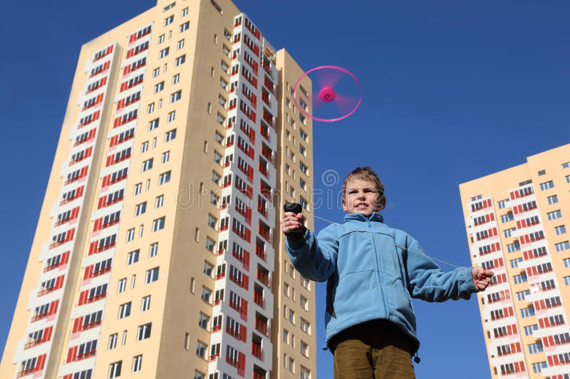 Download Boy In Blue Jacket Plays With Propeller Stock Photo - Image: 17413576