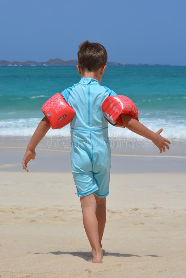 Boy on Blue Onesie on Beach during Day stock photos