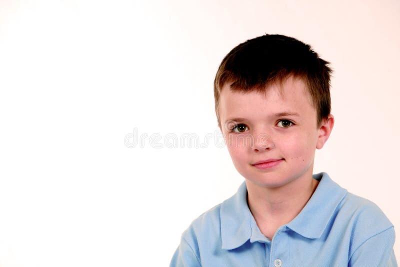 Boy in blue shirt stock photos