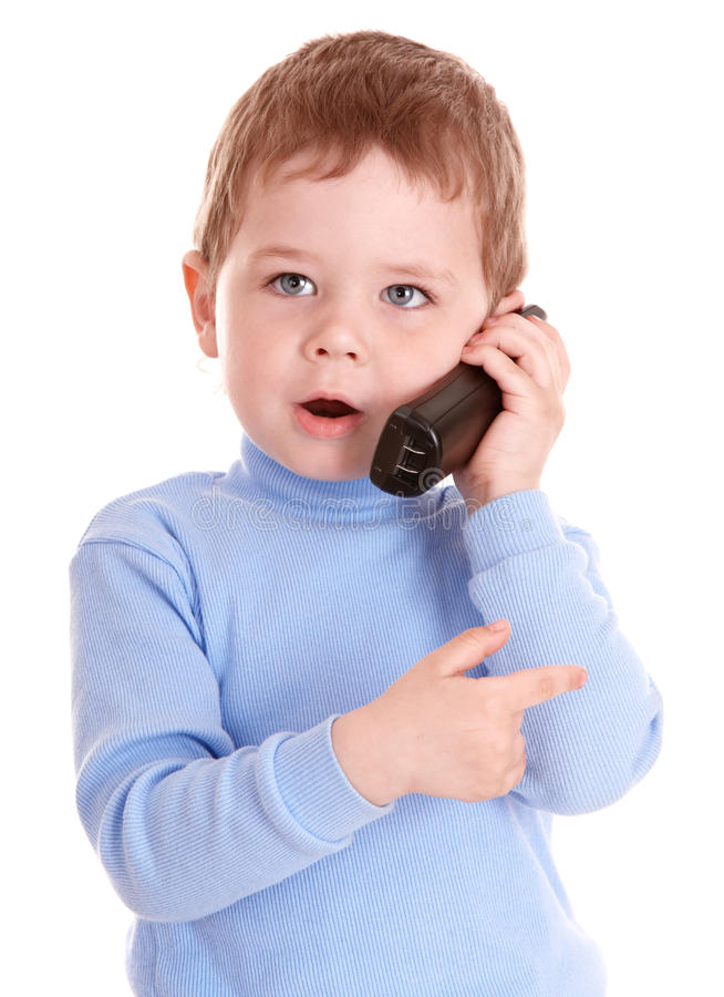 Boy in blue speak on phone. royalty free stock photo