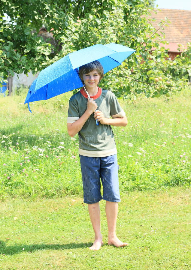 boy with blue umbrella stock photo image of little white 42627218