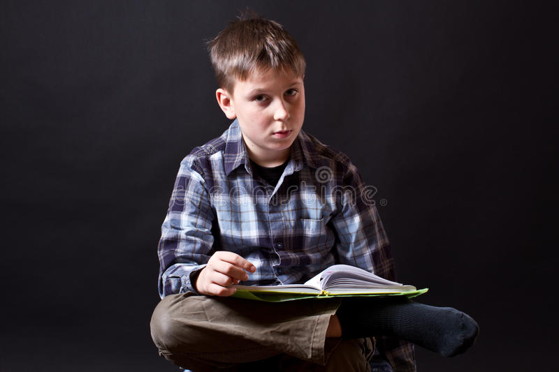 Download Boy with a book stock image. Image of shirt, teenager - 28230811