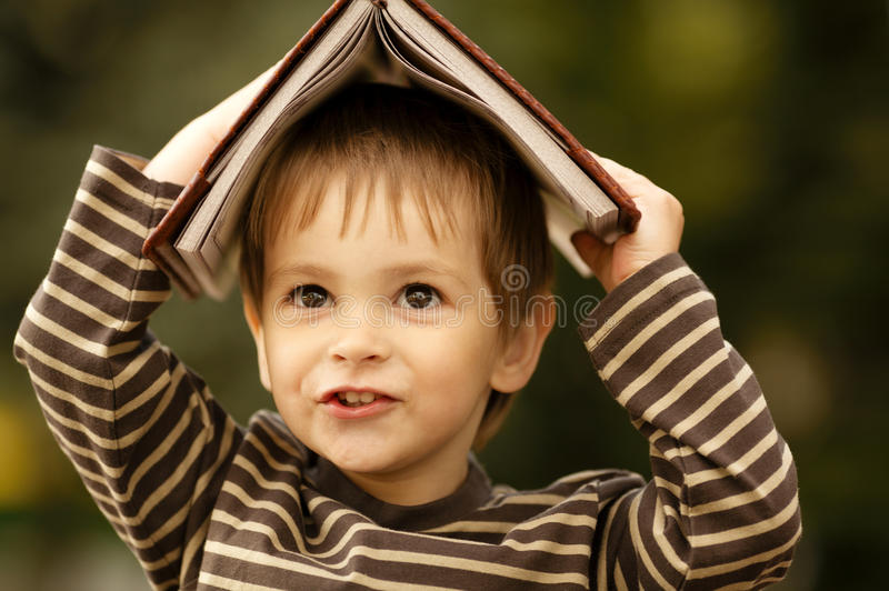 Download Boy with book stock photo. Image of people, angle, above - 28246648