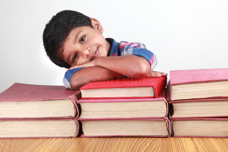 Boy and books stock photo