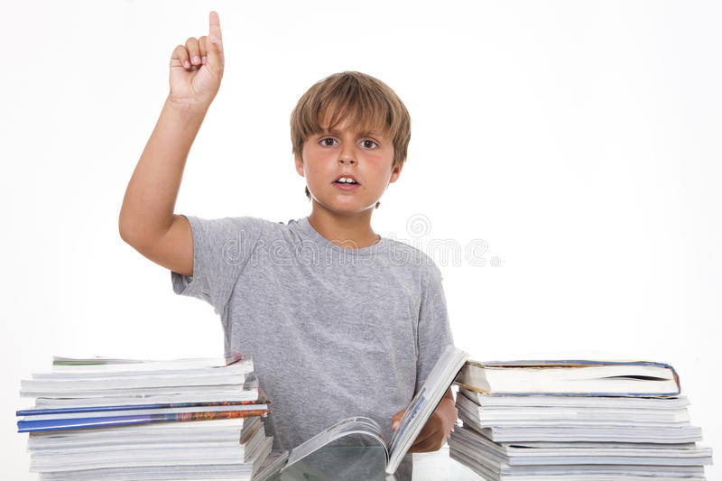 Boy with books showing attention royalty free stock photo