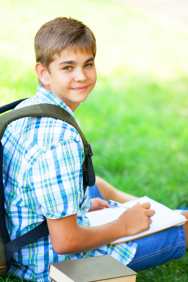 Download Boy with books stock image. Image of school, laying, education - 33684969