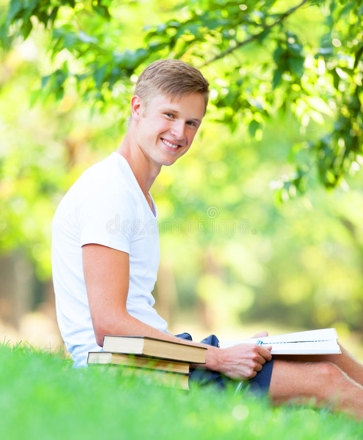 Download Boy with books stock photo. Image of male, learn, reading - 33684950