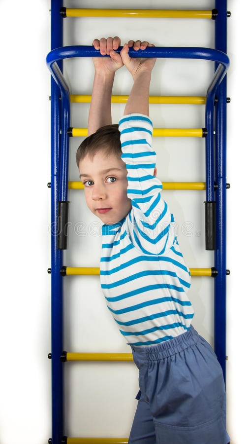 Boy with both hands holds on a horizontal bar royalty free stock images