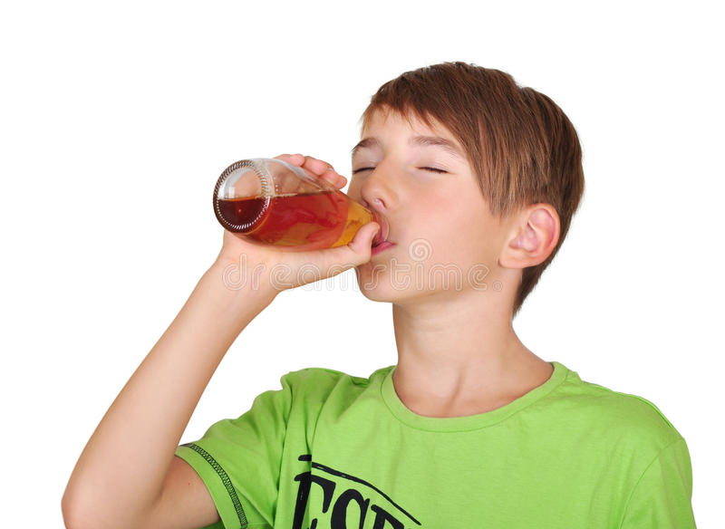 Boy with bottle of juice royalty free stock photo