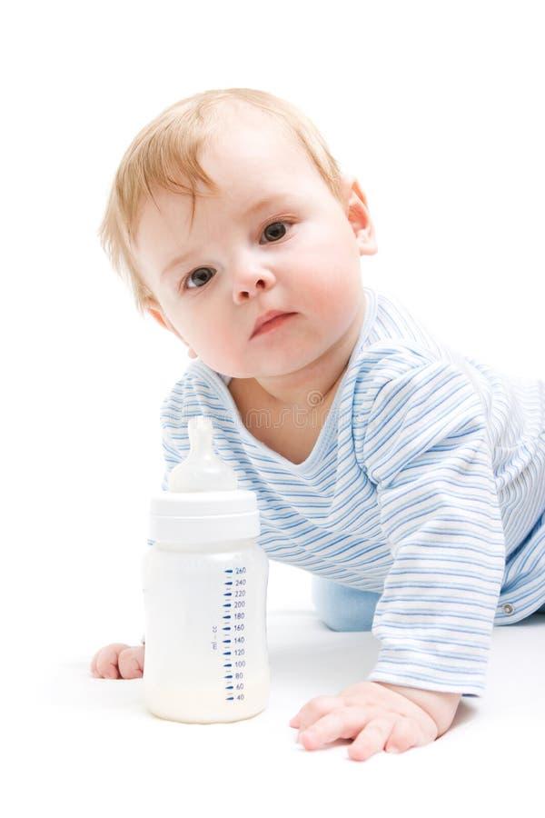 Boy with bottle of milk