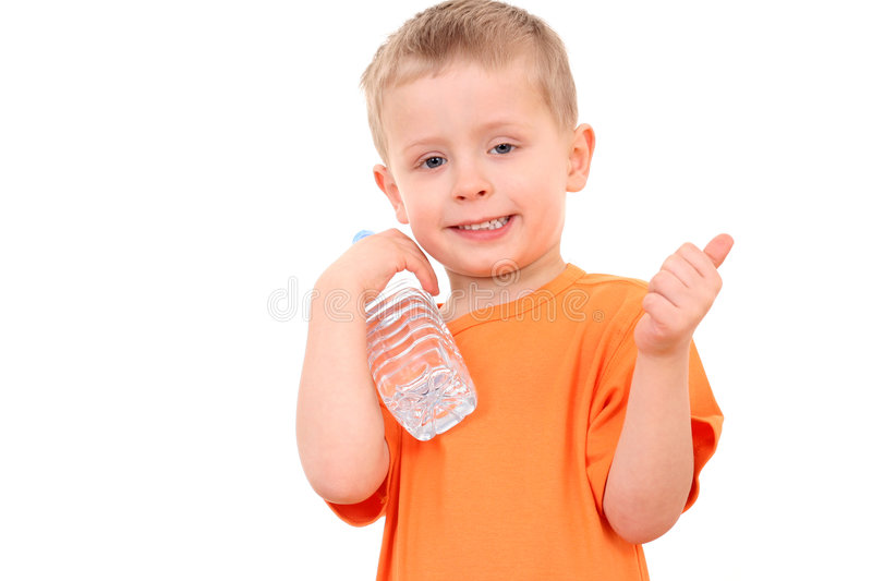 Boy and bottle of water stock photos