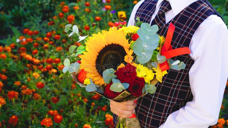 Boy with bouquet of flowers royalty free stock image