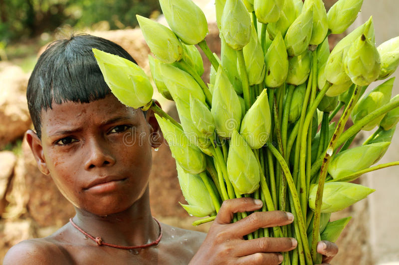 Boy with a bouquet of lotuses