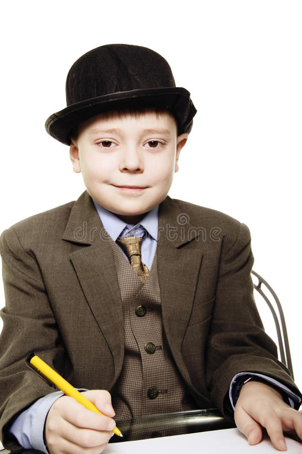 Boy In Bowler With Yellow Pen Royalty Free Stock Photo